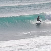 surfing a wave taghazout
